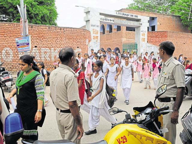 Students said men ogle at them and pass lewd comments while on their way to school and back. Two police personnel have been deployed at the entrance after complaints.