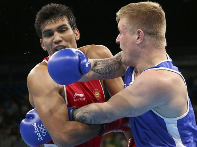 India's lightwelter boxer, Manoj Kumar (in red) taking on Lithuania's Evaldas Petrauskas in the first round of the Rio Olympics boxing competition. The world governing body has pulled up India for not wearing jerseys with the country's name.
