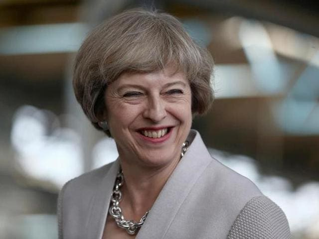 File photo of Britain's Prime Minister Theresa May visiting a factory in London on August 3.