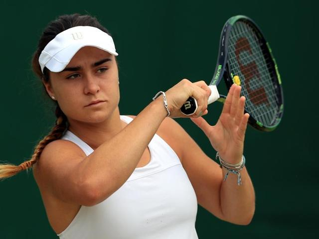 File photo of rising British tennis star Gabriella Taylor in action at Wimbledon. British police are investigating allegations that Taylor was poisoned while playing in the junior tournament, after she fell ill with a bacterial infection that can be spread through rat urine.