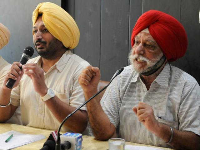 AAP volunteers DS Grewal (right) and Amandeep Singh Bains address the media in Chandigarh on Thursday.