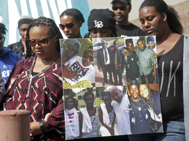 Family members of Donnell Thompson, 27, who was fatally shot by Los Angeles County Sheriff's deputies in Compton, Calif., speak to reporters outside the County Hall of Administration after addressing county supervisors in downtown Los Angeles Tuesday, Aug. 9, 2016.