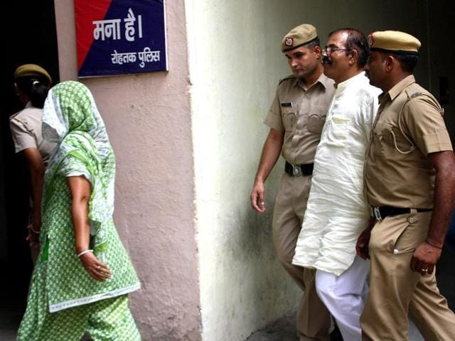 Accused Narender, his wife Rita and son Sunny outside a court in Rohtak on Wednesday.