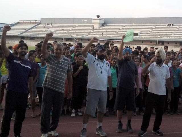 Sportspersons, coaches, parents, sports lovers and teachers protesting at Guru Nanak Dev Stadium on Tuesday evening in Ludhiana.