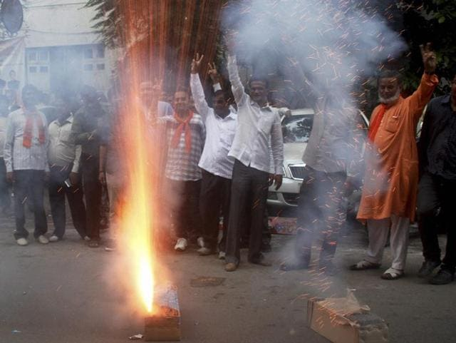 BJP supporters celebrate after Jitu Vaghani was appointed the new Gujarat BJP chief at party office in Ahmedabad.
