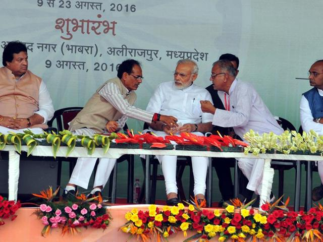 Prime Minister Narendra Modi, chief minister Shivraj Singh Chouhan and state BJP president Nandkumar Singh Chauhan at the public rally in Jhotrada village in Alirajpur district.
