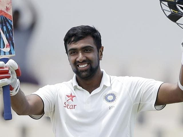 India's Ravichandran Ashwin celebrates after he scored a century against West Indies.