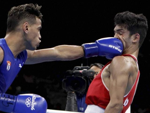 Robeisy Ramirez of Cuba is declared the winner over Shiva Thapa of India after their 56kg bantamweight bout.