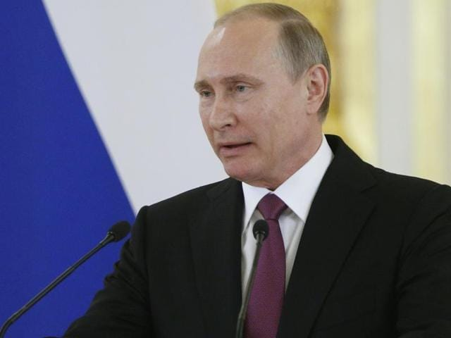 "Russian President Vladimir Putin accused the authorities in Kiev of ""practising terror"" and warned the deaths of the two Russian officers would have consequences."