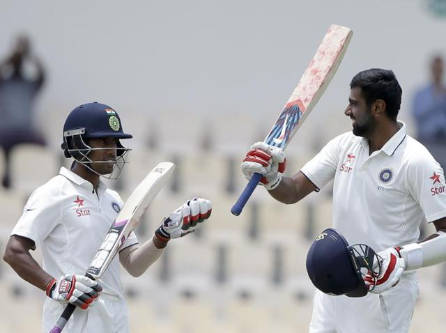 Ravichandran Ashwin and Wriddhiman Saha, part-time willow-wielders led the recovery.