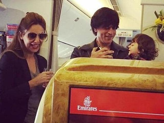 Scroll through for proof. Shah Rukh with wife Gauri and youngest son Abram heading back to Mumbai after their vacation in Dubai last year. Look at these three having a hearty laugh while boarding their flight. (Pinterest)