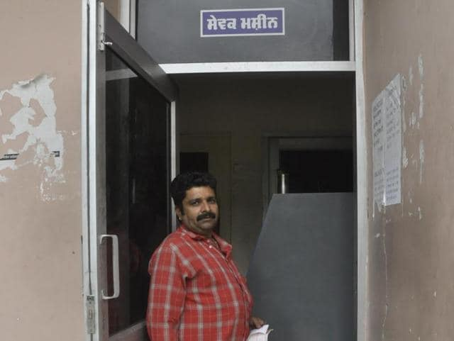 A consumer coming out after paying electricity bill through a machine at Old Baradari in Jalandhar on Thursday.