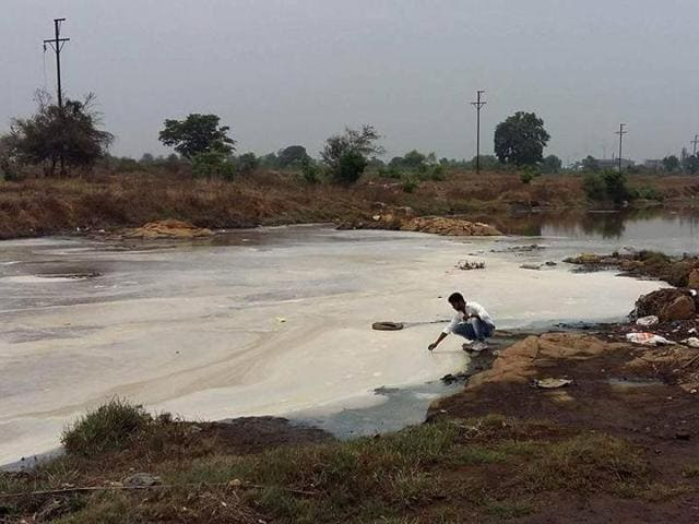The changed colour of the Kasadi river water that indicates the high level of pollutants in it. This has been killing the fish and affecting the livelihood of fishermen.