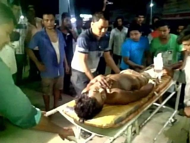 Injured being treated at a hospital in Assam's Tinuskia district. Suspected Ulfa(I) insurgents opened fire on two houses, targeting Hindi speakers during a Kirtan.