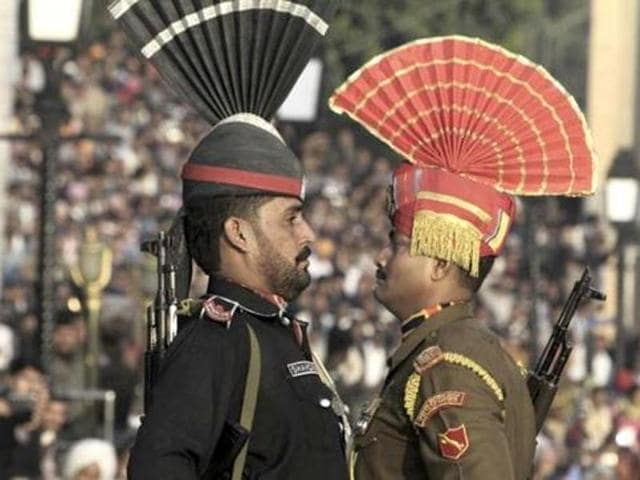 A Pakistani Ranger in black uniform and his Indian counterpart at the Wagah Border.