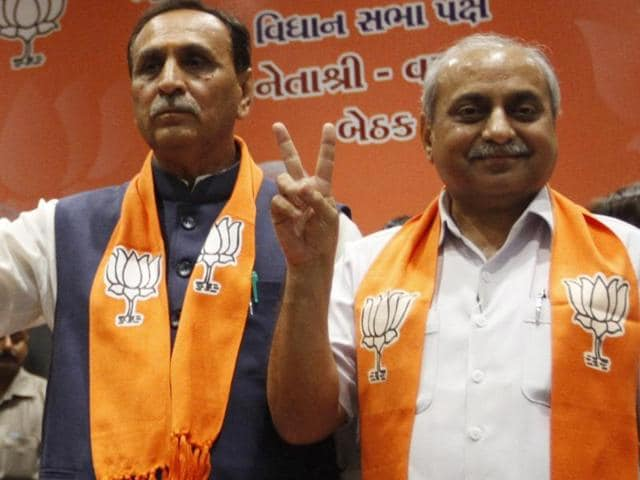 State BJP president Vijay Rupani and minister Nitin Patel elected as chief minister and deputy chief minister during a legislative meeting in Gandhinagar, Gujarat, on August 5, 2016.