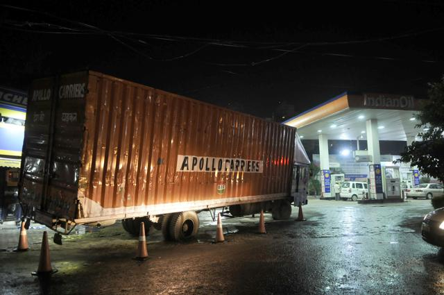 The truck, carrying two-wheelers, was moving towards the petrol pump to refuel when it came in contact with wires and emitted sparks.