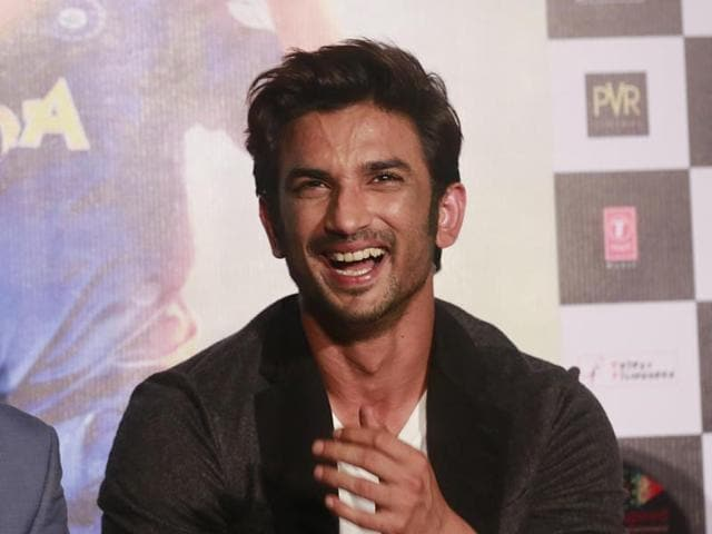 Indian cricketer Mahendra Singh Dhoni, left, shares a light moment with Bollywood actor Sushant Singh Rajput as they speak with the media during the trailer launch of upcoming movie MS Dhoni: The Untold Story in Mumbai on Thursday.