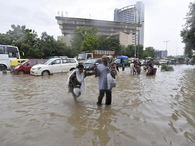 Water logging after heavy rain near Zakir Hussain College in New Delhi on Friday.