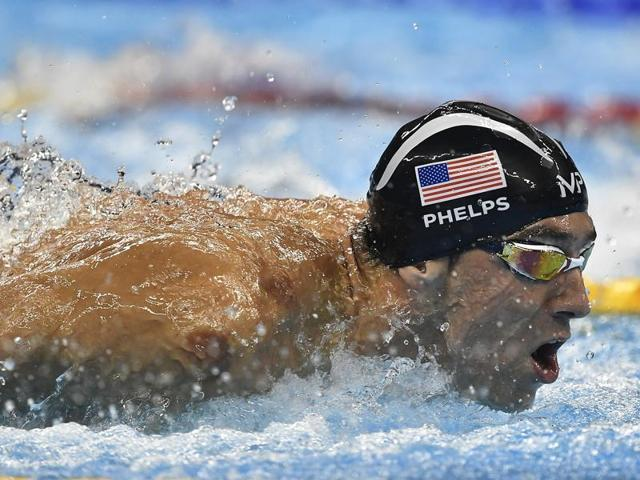 United States' Michael Phelps, centre, is flanked by Ryan Lochte, right, and Brazil's Thiago Pereira in the 200m individual medley final.