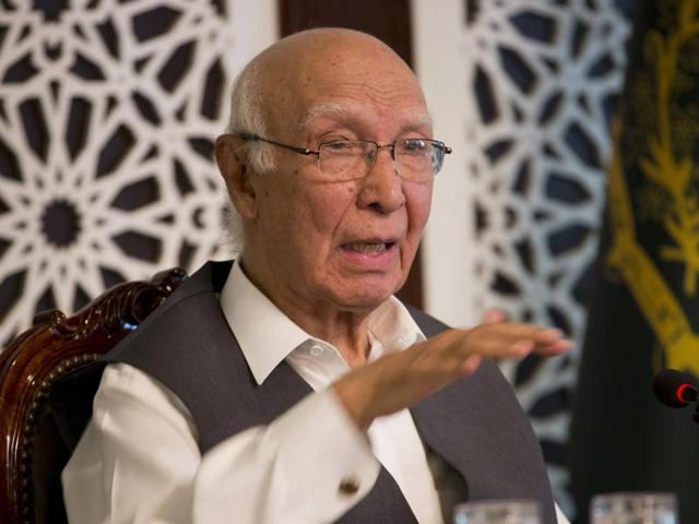 Pakistani prime minister's adviser on foreign affairs, Sartaj Aziz, addresses a news conference in Islamabad on Friday.