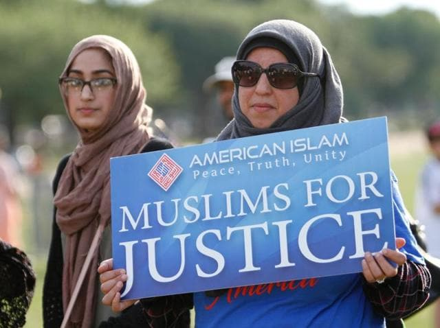 Muslim women take part in a rally at National Mall in Washington. A Muslim woman is suing the city of Chicago and six officers who falsely singled her out as a potential terrorist.