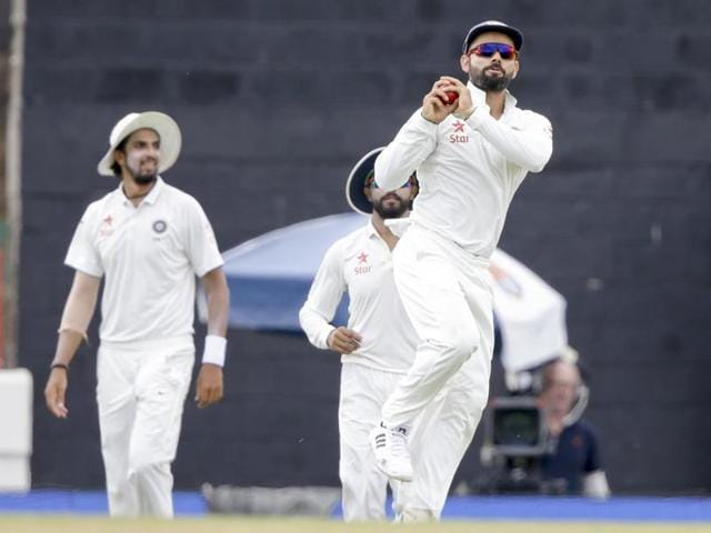 India's captain Virat Kohli leads his team into the field for the first session of day four of the third cricket Test match against West Indies at the Daren Sammy Cricket Ground in Gros Islet, St. Lucia on August 12, 2016.