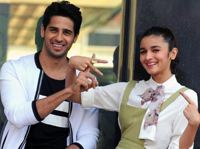 Sidharth Malhotra and Alia Bhatt pose during a promotional event for their film Kapoor and Sons in Mumbai. (AFP)