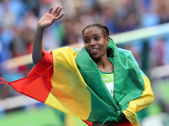 Ethiopia's Almaz Ayana's winning time of 29min 17.45sec sliced nearly 14 seconds off the previous world best of 29:31.78 set by Wang Junxia in 1993.