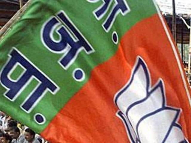 A local BJP worker was reportedly killed and several others injured in police firing in Ballia district .