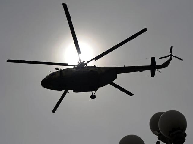 This file photo shows a Pakistani Air Force Mi-17 helicopter flies over the Presidential Palace in Islamabad.