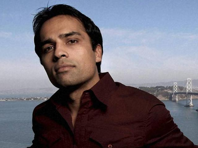 Gurbaksh Chahal stands in his San Francisco high-rise penthouse in downtown San Francisco.