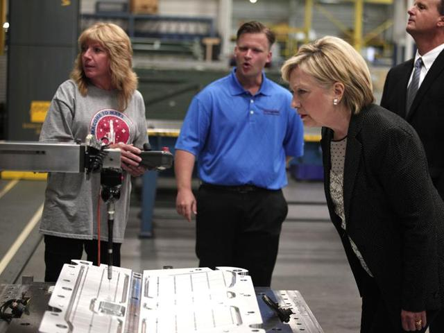 Hillary Clinton tours a factory in Warren, Michigan,  before giving a speech there on the U.S. economy.