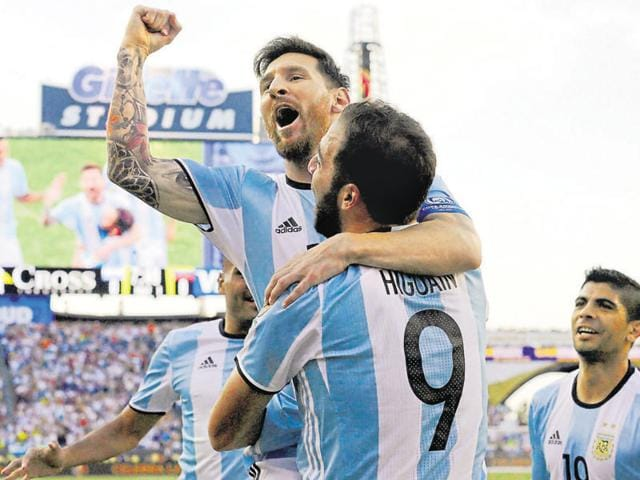 Argentina's Lionel Messi, top, celebrates a goal by Gonzalo Higuain (9).
