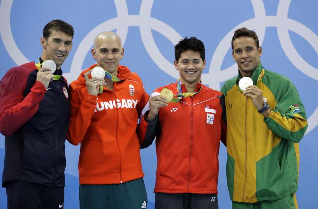 United States' silver medal winner Michael Phelps, Hungary's silver medal winner Laszlo Cseh, Singapore's gold medal winner Joseph Schooling and South Africa's silver medal winner Chad Le Clos, from left, in the men's 100-meter butterfly medals ceremony during the swimming competitions at the 2016 Summer Olympics.