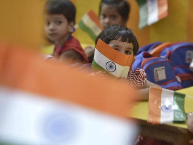 Students hold handmade national flags during celebrations of India's Independence Day at a school in New Delhi.