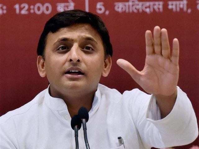 The Akhilesh Yadav government in UP has suspended a district magistrate and a superintendent of police for alleged dereliction of duty over a BJP worker's death.