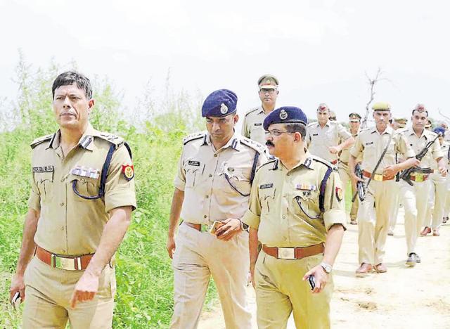 Senior Uttar Pradesh police and STF officials visit the spot where BJP leader Brijpal Teotia's car was shot at multiple times in Ghaziabad's Murad Nagar town.
