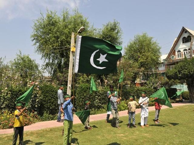 A Kashmiri boy holds the Pakistan flag during celebrations to mark the country's 70th Independence Day in Srinagar.