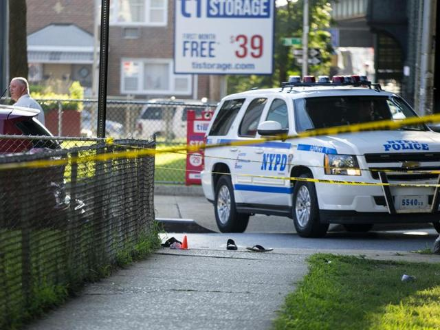 Sandals lay on a street corner at the crime scene not far from the Al-Furqan Jame Masjid Mosque in the Ozone Park neighbourhood of Queens, New York, where the leader of a New York City mosque was fatally shot.(AP)