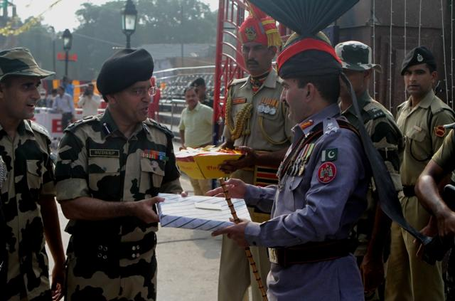 Sweets being exchanged at the Pakistan-India border post at Wagah near Lahore on the Pakistan Independence Day on Sunday.
