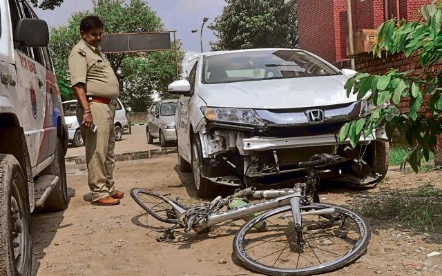 Mangled remains of the cycle that was being ridden by victim Ajay Gupta and the car that hit it in Panchkula.