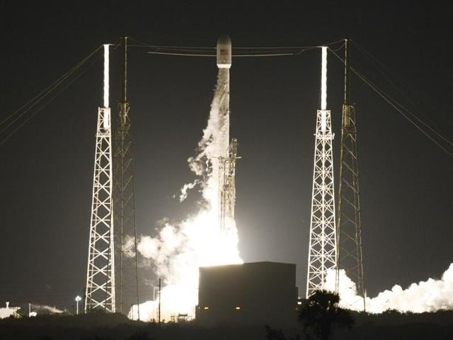 A SpaceX Falcon 9 rocket launches from Launch Complex 40 at Cape Canaveral Air Force Station in Florida with a Japanese communications satellite early on Sunday.