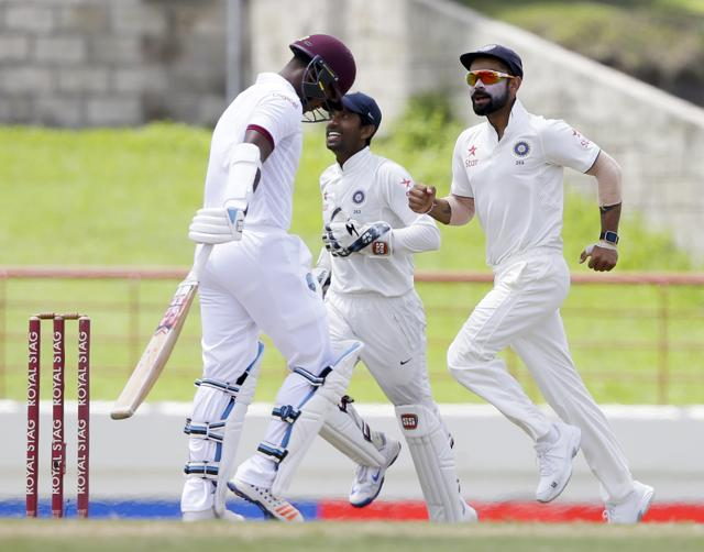 India's captain Virat Kohli, left, and  Ajinkya Rahane, right, leave the field after beating West Indies by  237 runs on day five of their third Test in Gros Islet, St. Lucia, on Saturday.