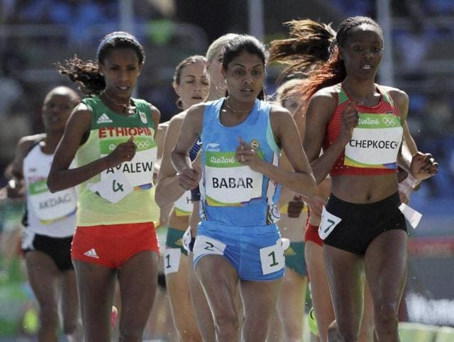 Lalita Babar, center, will compete in the women's 3,000-metre steeplechase finals at the 2016 Summer Olympics in Rio de Janeiro on Monday.