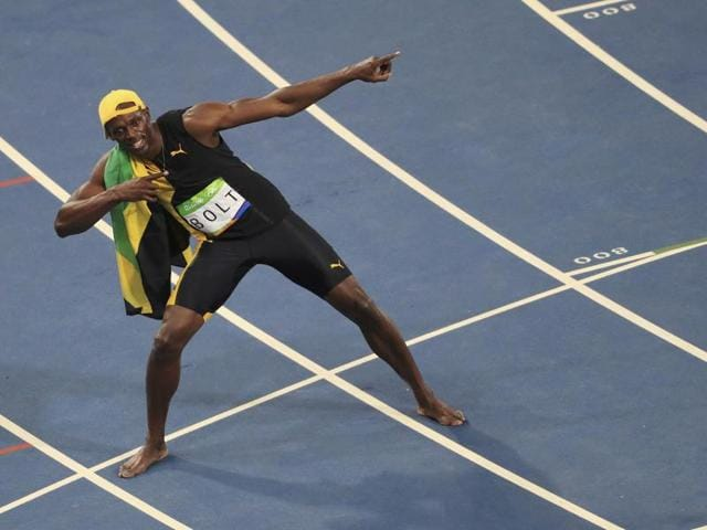 Jamaica's Usain Bolt crosses the line to win gold in the men's 100-metre final.
