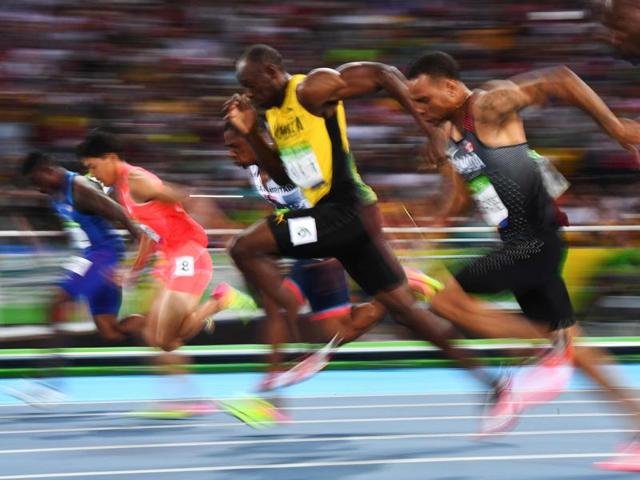 Jamaica's Usain Bolt, centre, competes in the Men's 100m Semifinal during the athletics event at the Rio 2016 Olympic Games in Rio de Janeiro.