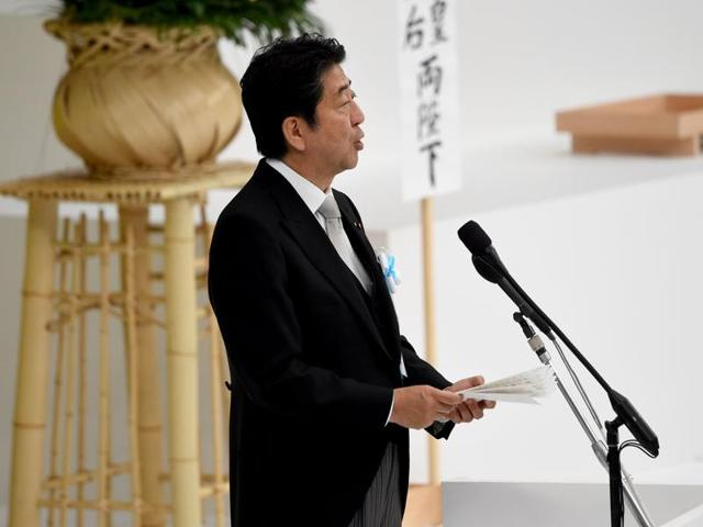 Japanese Prime Minister Shinzo Abe gives a speech during the official annual memorial service for war victims in Tokyo on August 15, 2016.