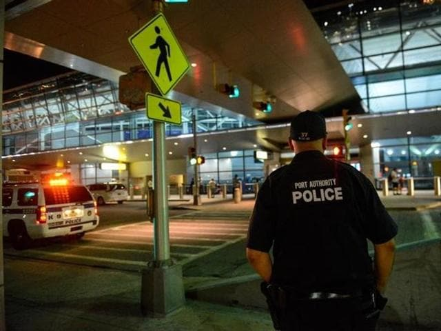 Members of the New York City Police Department stand guard at Terminal 8 at John F. Kennedy airport in the Queens borough of New York City on August 14, 2016.