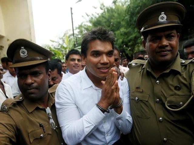 Namal Rajapaksa (C), son of former Sri Lanka's President Mahinda Rajapaksa, leaves with prison officers at court after being arrested in Colombo, Sri Lanka July 11, 2016.